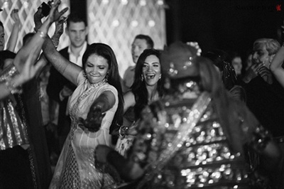 A candid picture of the bride dancing at her sangeet