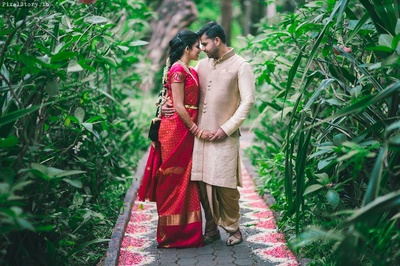Pratibha looking beautiful in this red and gold South Indian Saree and Ashwin dressed royally in off white Bandhgala and Dhoti .