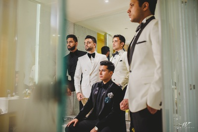 The groom and his groomsmen getting ready for the cocktail party before the wedding