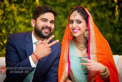 Kesari silk dupatta complementing the two-toned stunning lehenga set for the Roka ceremony