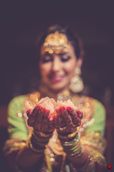Unique bridal shot of the beautiful engagement ring and mehendi by ace photographer Abhinav