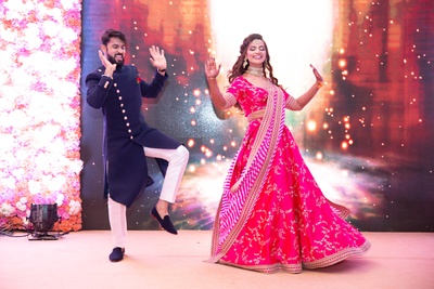 a candid capture of the couple dancing at their sangeet