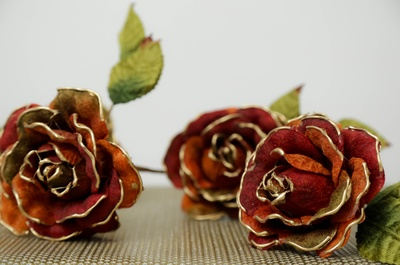 Artificial red and gold handmade roses for the bridesmaids