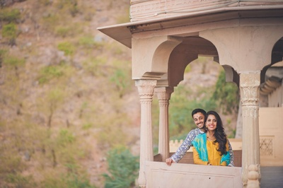 Enjoying their pre wedding photo shoot by scenic locations of Neemrana Fort Palace