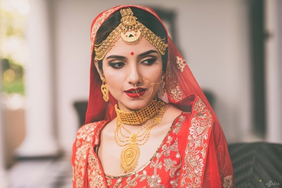 Bridal close up showcasing minimal bridal makeup ad gold jewellery