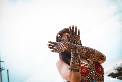 Mehndi Photoshoot with a quirky pose.