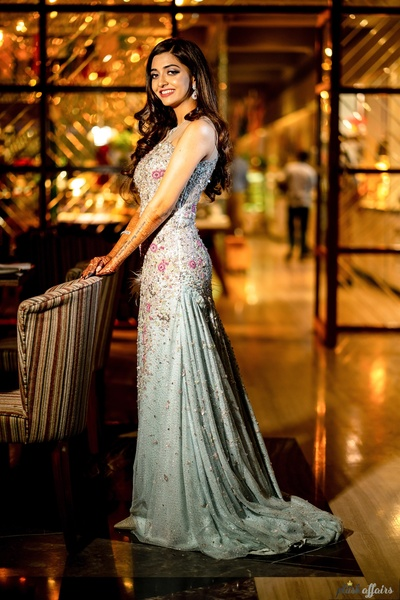 the bride looks stunning in an embellished blue gown for her engagement cum cocktail party