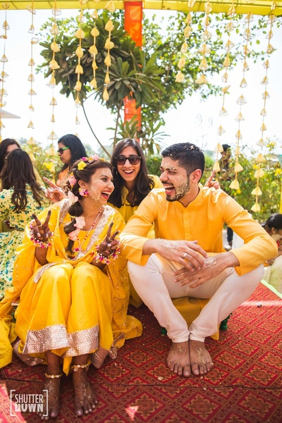 bride and groom in a lovely Haldi ceremony shot