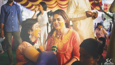 Colored in Haldi with a gajra wrapped around her braid, she looks so happy