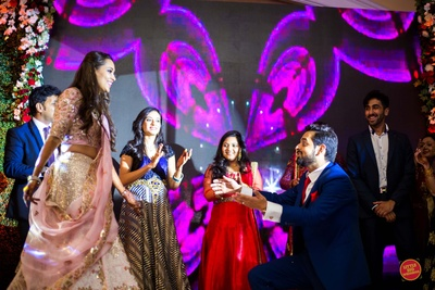 Bride and groom dance together during the sangeet ceremony