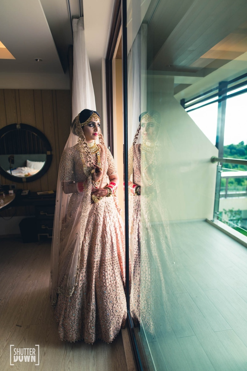 9. This bride's blush pink lehenga is oh-so-amazing!