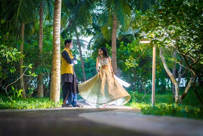 Bride twirling with groom during their sangeet function photoshoot