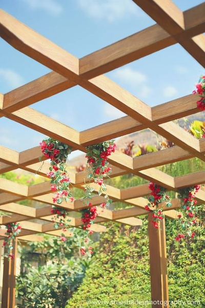 Wooden arbor decorate with fresh clustered floral hangings
