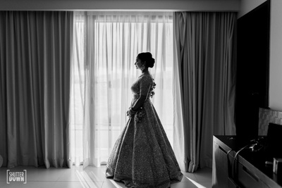 black and white side portrait of the bride just before the wedding