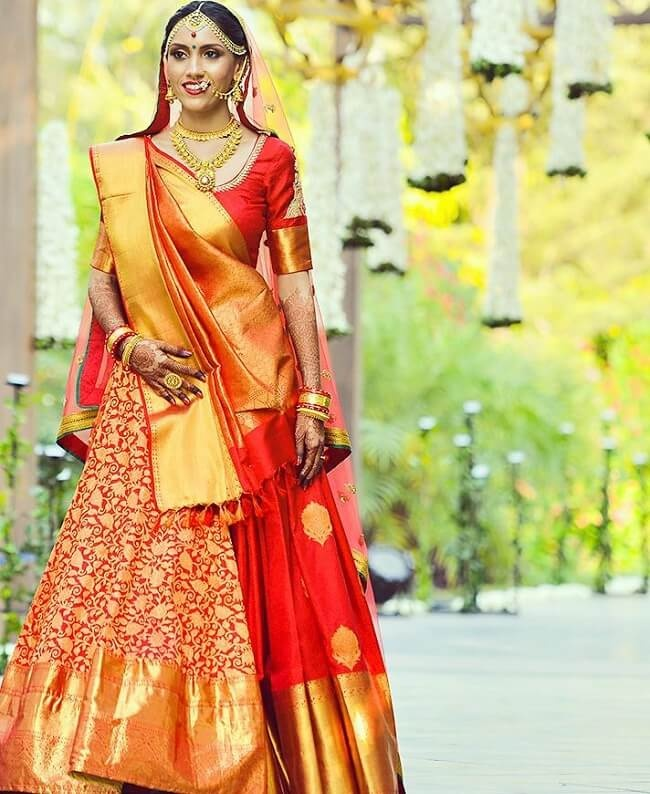 cf2054de0d8509 Red and gold is a classic combo for a wedding saree or lehenga. Loving how  this bride has carried off an all red Banarasi lehenga with such grace!