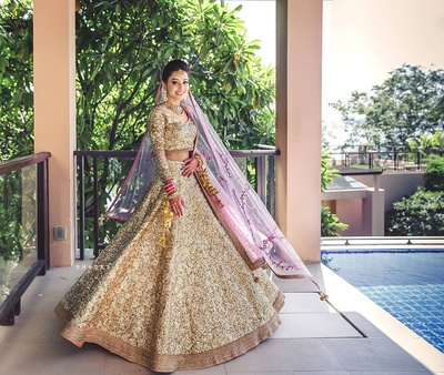 Looking absolutely gorgeous in this glittering gold bridal wear.