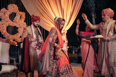 Bride and groom in the wedding mandap taking the holy saat pheras