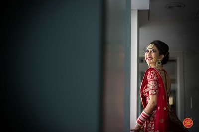 The bride in her red lehenga for her Sikh wedding
