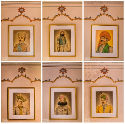 Chomu Palace walls adorned with portraits of the royal lineage