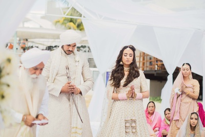 Ceremonial wedding photography of the bride and groom together at the mandap