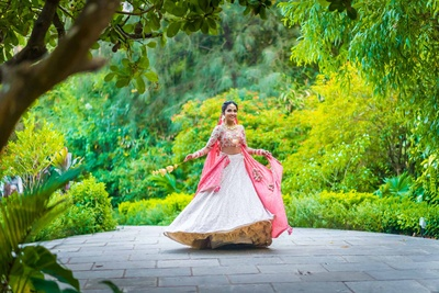 Traditional bride twirling for WhatKnot Photography before the wedding function starts