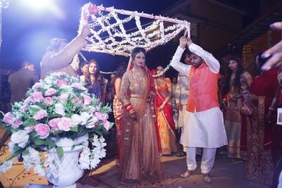 Spectacular bridal entry under a phulo ki chaddar