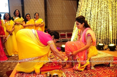 Ladies of the family dressed in yellow outfits for the haldi ceremony