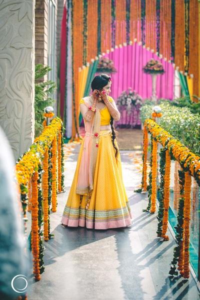beautiful bride in a yellow lehenga for her haldi day