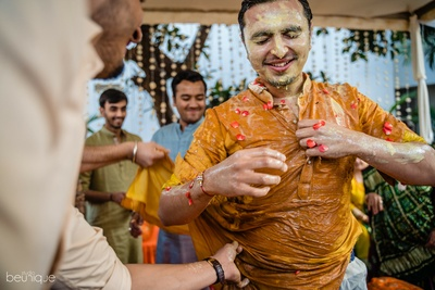 the groom drenched in water at his haldi ceremony