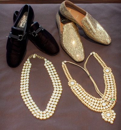 Martin and Amits's footwear and necklaces captured in one frame