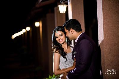 Bride and groom pose together during the sangeet function at  Bal Samand Lake Palace, Jodhpur