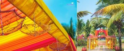 Vibrant drapes along with sheer upturned umbrellas serve as an intriguing wedding decor idea.