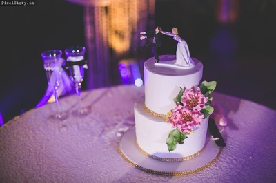 Cute and quirky wedding cake !