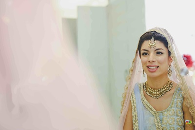 Bride's reflection caught by Nitin Arora Photography as she gets ready for the wedding