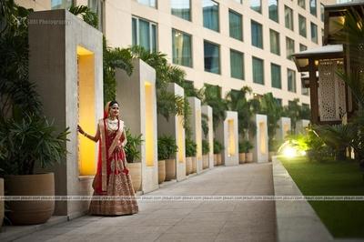 Red wedding lehenga by Sabyasachi styled with polki studded necklace set and matching raani haar