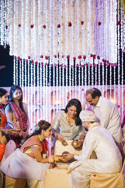 The family and the couple participate in a ritual during the wedding!