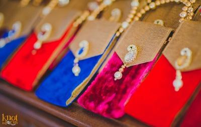 Paisley embellishments adorned on the velvet pouch