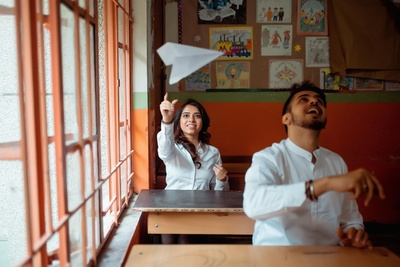 The couple share an enjoyable moment with a paper plane!