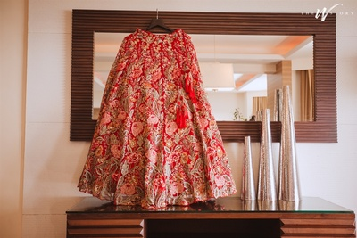 beautiful shot of the detailed red lehenga by Shyamal and Bhumika
