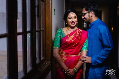 the bride and groom dressed in silk for their wedding function