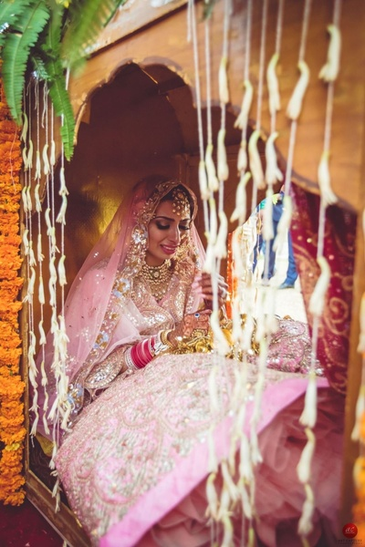 Emotional photograph of the bride in her palanquin after vidaai