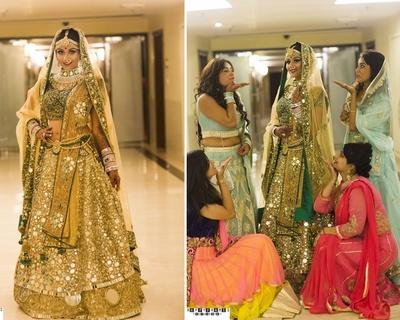 Deep green bridal lehenga embellished with heavy mirror work with sheer dupatta for wedding