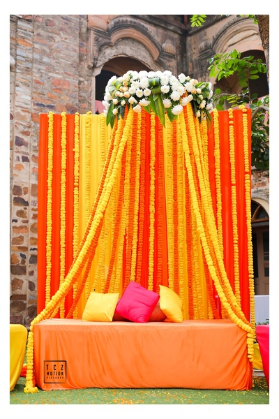 colourful and bright genda phool decor ideas for the mehendi ceremony