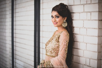 Gold chandbalis paired with peach and gold anarkali for the engagement ceremony.