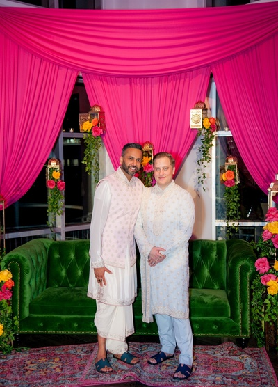 the grooms posing at their sangeet ceremony