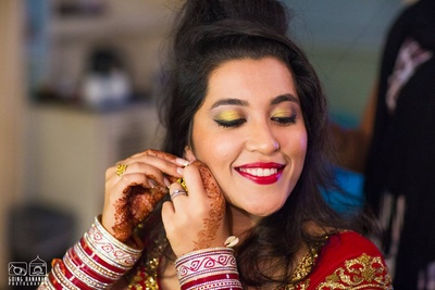 Red lips and gold eyeshadow to go with the red and gold bridal lehenga