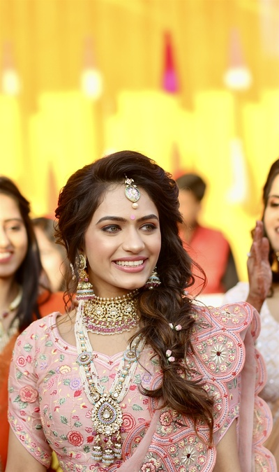 Candid picture of the bride during the mehendi ceremony