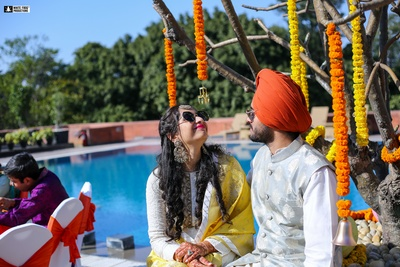 a cute picture of the bride and groom at the mehendi ceremony
