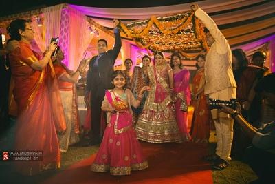 Entering the wedding venue dressed in regal wedding lehenga and exquisite wedding jewellery