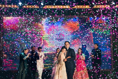 Celebration, fun and paper confetti- looks like everyone is having a gala time at the sangeet ceremony!